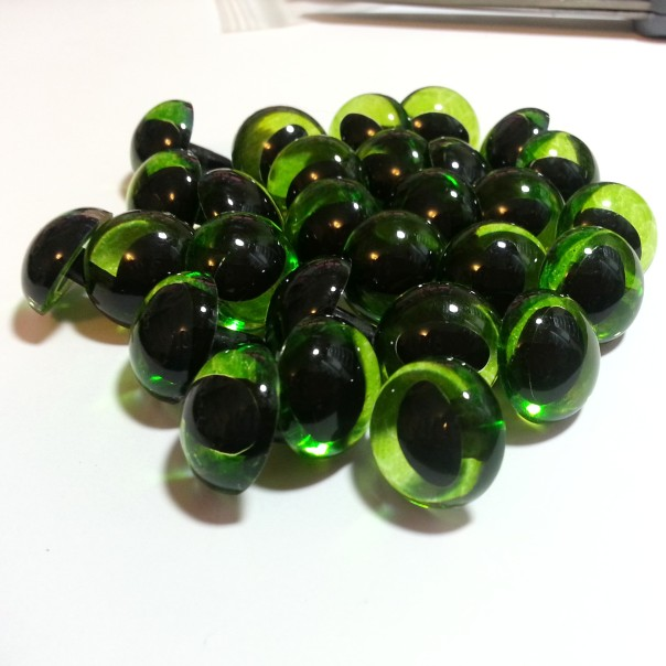 Lots of translucent olive cat eyes on their way to Canada